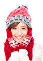 young smiling woman in winter clothes and touching face - isolated on white background - PhotoDune Item for Sale