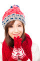 close up of beautiful asian woman in hat, muffler and mittens. happiness concept - PhotoDune Item for Sale