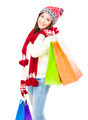 happy young woman holding shopping bags.  Christmas shopping concept. - PhotoDune Item for Sale