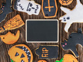 Handmade Halloween cookies on a wooden background - PhotoDune Item for Sale