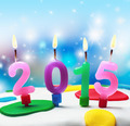 burning candles with the symbol of the new year 2015 on the cake - PhotoDune Item for Sale