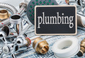 plumbing and blackboard on wooden table - PhotoDune Item for Sale
