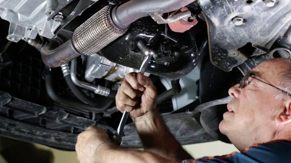 Car Repair Mechanic Removing the Oil Cap