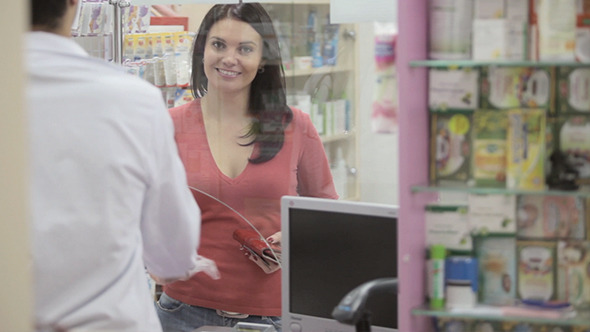 Client Buying Drugs In A Pharmacy