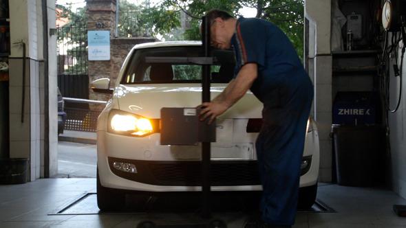 VideoHive Car Repair Mechanic Adjusting Headlights 9321775