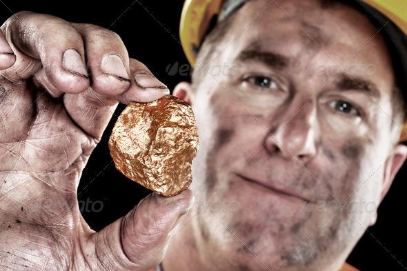 PhotoDune Gold miner with nugget 952424