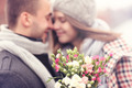 Flowers and kissing couple in the background - PhotoDune Item for Sale