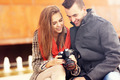 Young couple checking pictures on their camera - PhotoDune Item for Sale