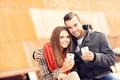 Autumn couple with smartphones - PhotoDune Item for Sale