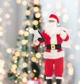 man in costume of santa claus with notepad and bag - PhotoDune Item for Sale