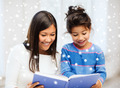 mother and daughter with book indoors - PhotoDune Item for Sale