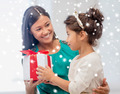 happy mother and child girl with gift box - PhotoDune Item for Sale