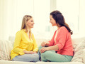 two girlfriends having a talk at home - PhotoDune Item for Sale