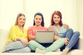 three smiling teenage girls with laptop at home - PhotoDune Item for Sale