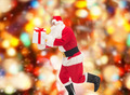 man in costume of santa claus with gift box - PhotoDune Item for Sale