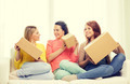 smiling teenage girls with cardboard boxes at home - PhotoDune Item for Sale