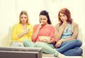 three sad teenage girl watching tv at home - PhotoDune Item for Sale
