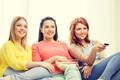 three smiling teenage girl watching tv at home - PhotoDune Item for Sale