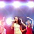 three smiling women dancing and singing karaoke - PhotoDune Item for Sale