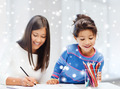 mother and daughter with coloring pencils indoors - PhotoDune Item for Sale