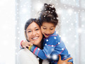 smiling little girl and mother hugging indoors - PhotoDune Item for Sale