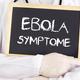 Doctor shows information: Ebola symptoms in german - PhotoDune Item for Sale