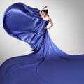 Young Beauty Woman In Fluttering Blue Dress. - PhotoDune Item for Sale