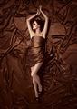 Beautiful Woman Lying On A Chocolate Fabric. - PhotoDune Item for Sale