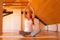 Woman practicing Yoga in a Studio - PhotoDune Item for Sale