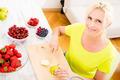 Mature woman preparing a smoothie - PhotoDune Item for Sale