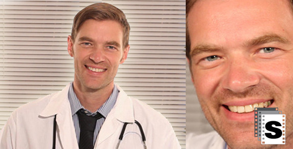 Doctor In Office Smilling