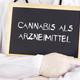 Doctor shows information on blackboard: medical cannabis in german - PhotoDune Item for Sale