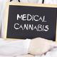Doctor shows information on blackboard: medical cannabis - PhotoDune Item for Sale