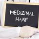 Doctor shows information on blackboard: medical marijuana in german - PhotoDune Item for Sale