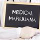 Doctor shows information on blackboard: medical marijuana - PhotoDune Item for Sale