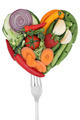 Vegetables love heart on a fork