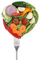 Vegetables and fruits on a fork