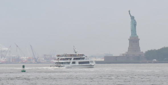 Statue of Liberty with Passing Ferry