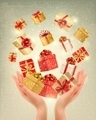 Christmas gold background with gift boxes and hands.  - PhotoDune Item for Sale
