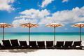 Turquoise Sea, Deckchairs, White Sand And Beach Umbrellas.  - PhotoDune Item for Sale