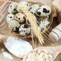 Quail eggs, flour and cooking utensils on canvas. - PhotoDune Item for Sale