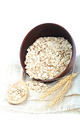 Oatmeal flakes in bowl on white background. Healthy food. - PhotoDune Item for Sale