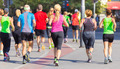 Group of people running.