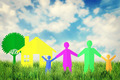 Concept of happy family near their home outdoors against blue sky - PhotoDune Item for Sale