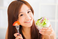 beautiful girl eating healthy food.health life concept - PhotoDune Item for Sale