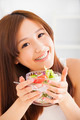 beautiful asian young woman eating salad.healthy life concept - PhotoDune Item for Sale