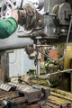 machinist working on industrial drilling machine in workshop - PhotoDune Item for Sale