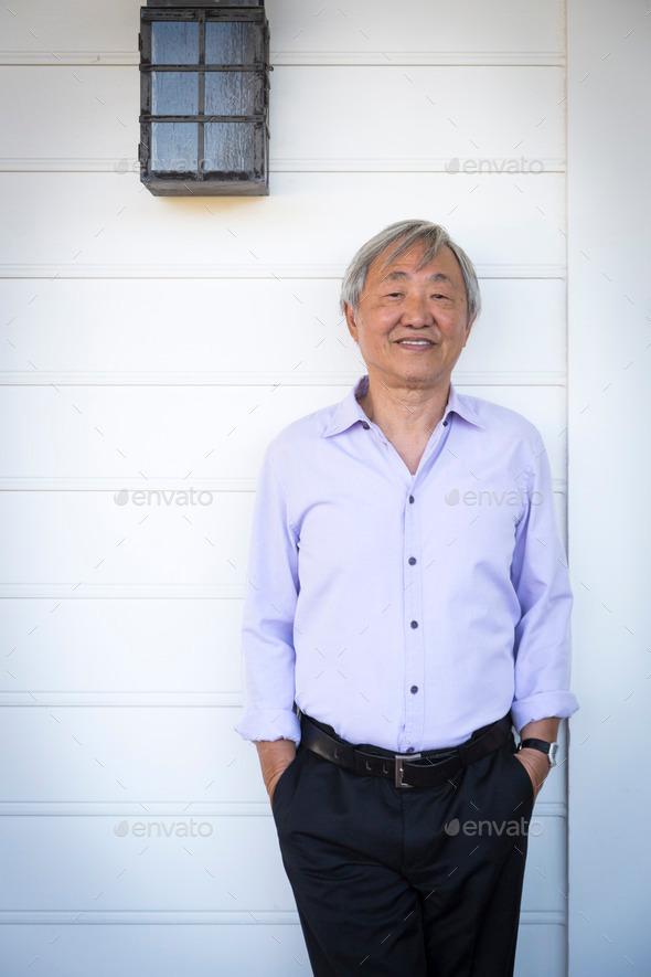 Happy Attractive Older Chinese Man Portrait.