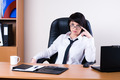 Attractive businesswoman working on laptop in office - PhotoDune Item for Sale