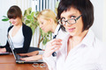 Beautiful businesswoman in office over colleagues background - PhotoDune Item for Sale